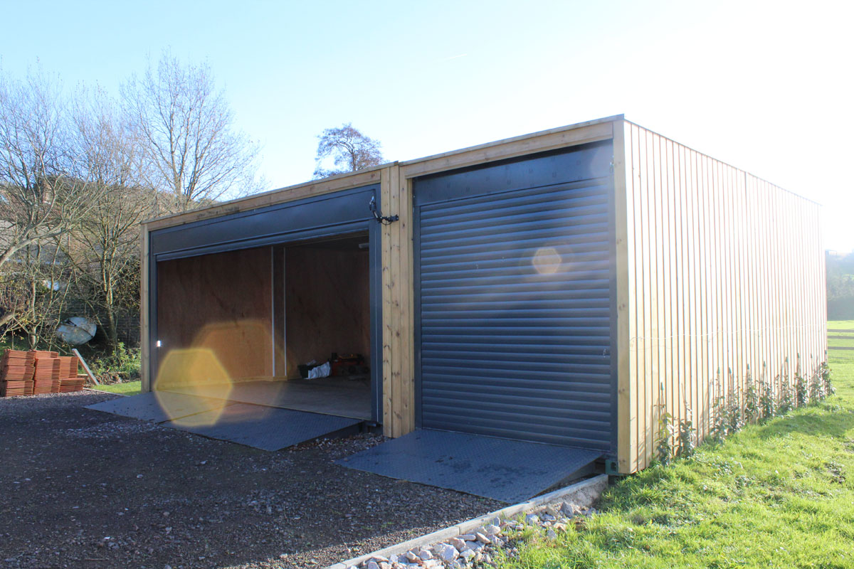 shipping container garage cladded with roller shutter