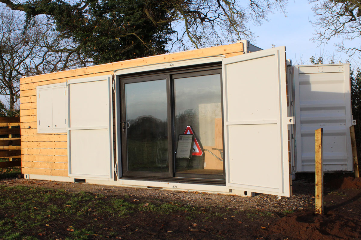 cladded container workshop with sliding doors