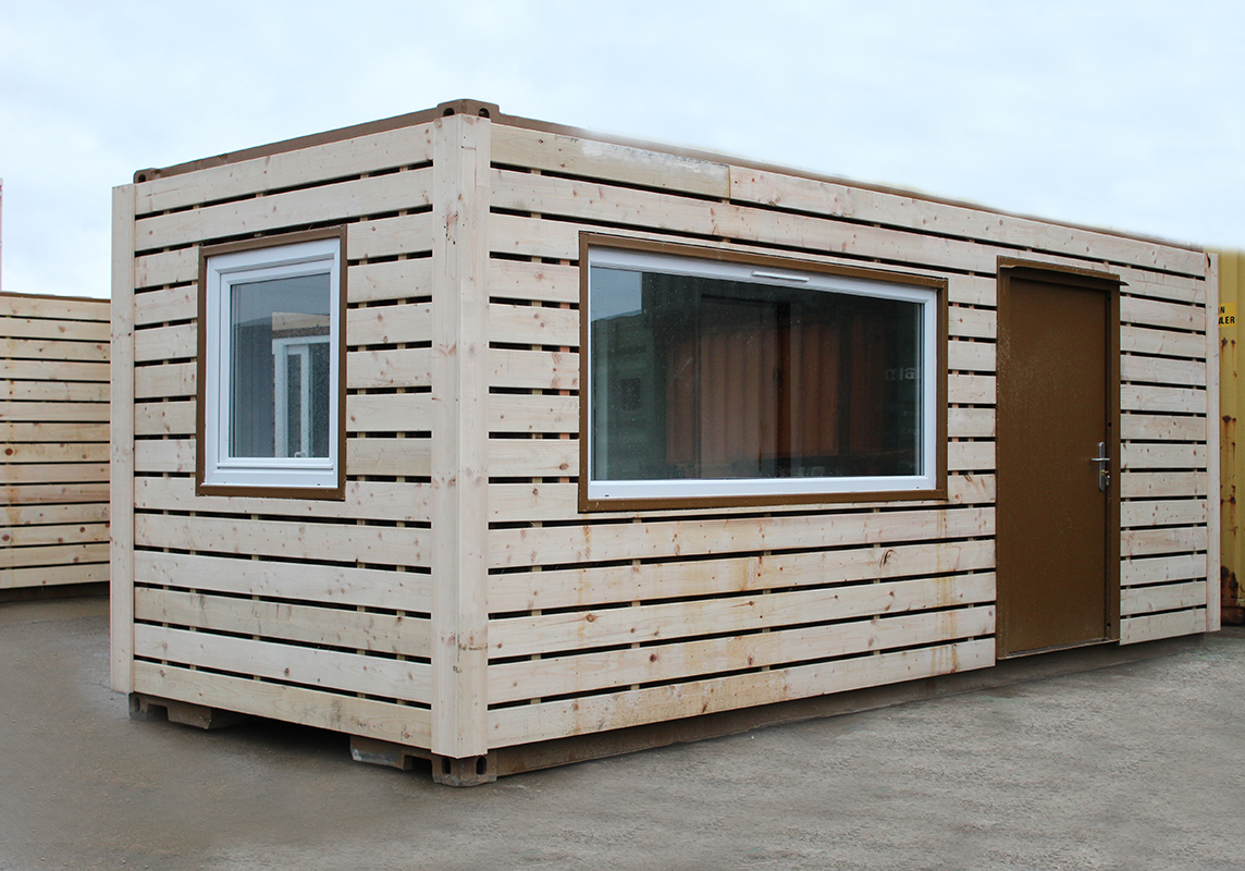 wood clad shipping container with windows and doors