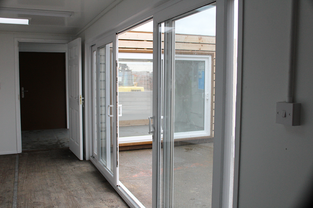 shipping container with sliding patio doors