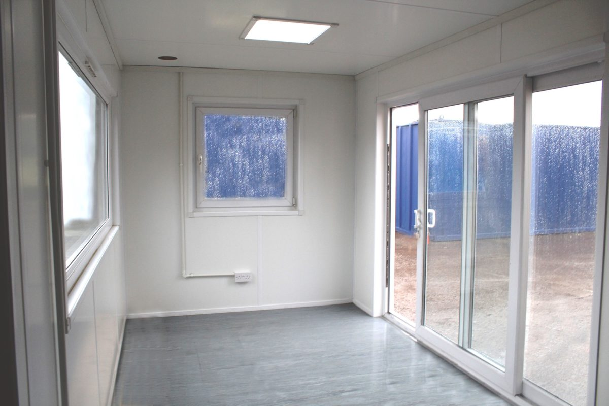 shipping container conversion with doors and windows