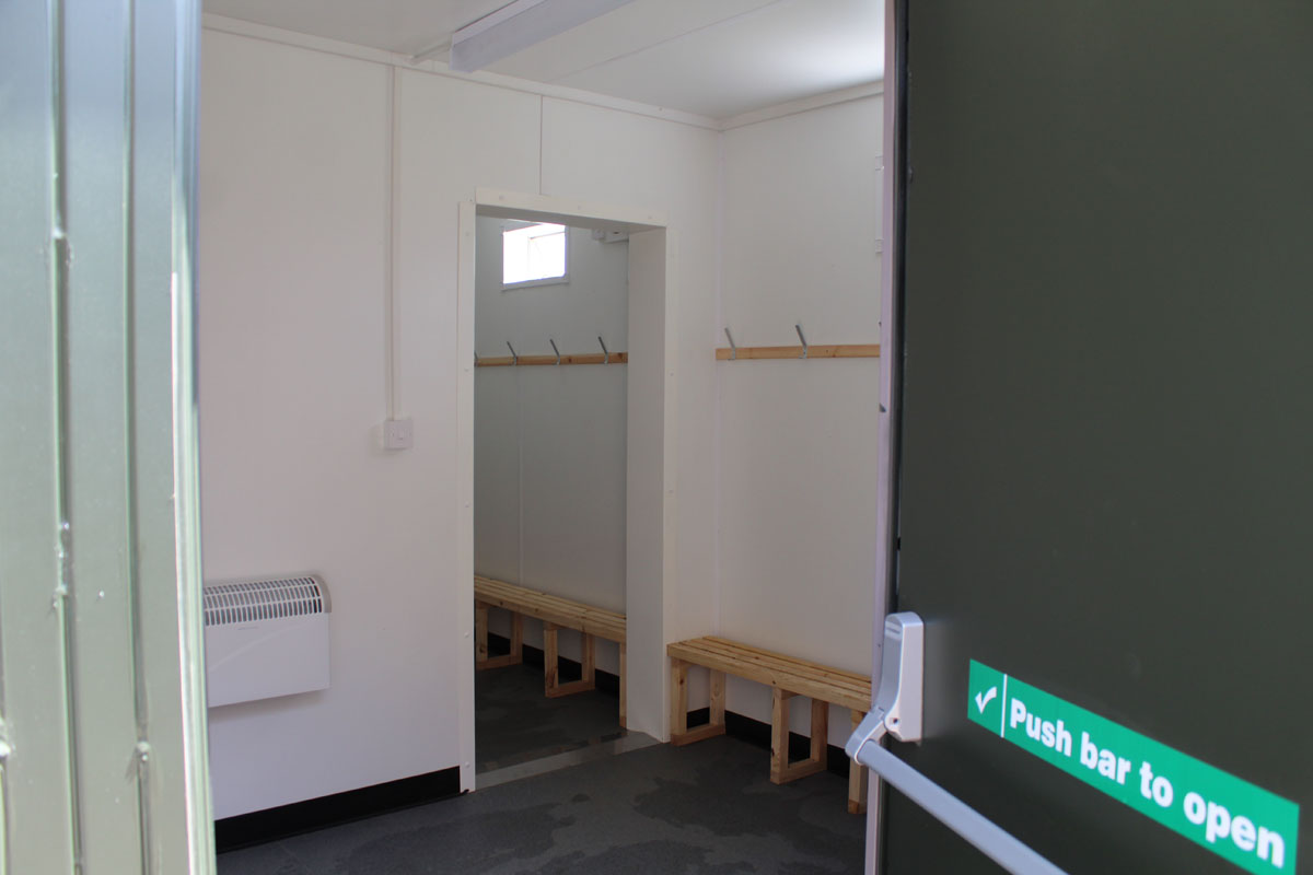 Container converted into swimming pool changing rooms inside