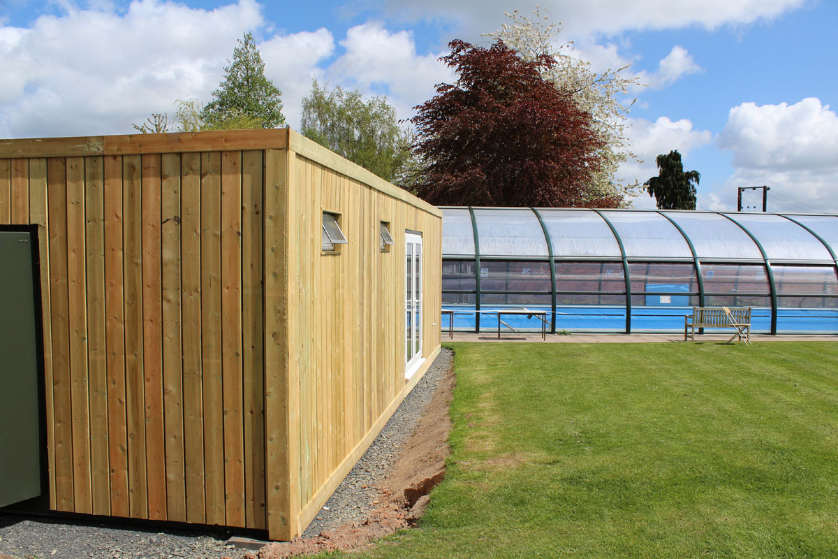 Container converted into swimming pool changing rooms