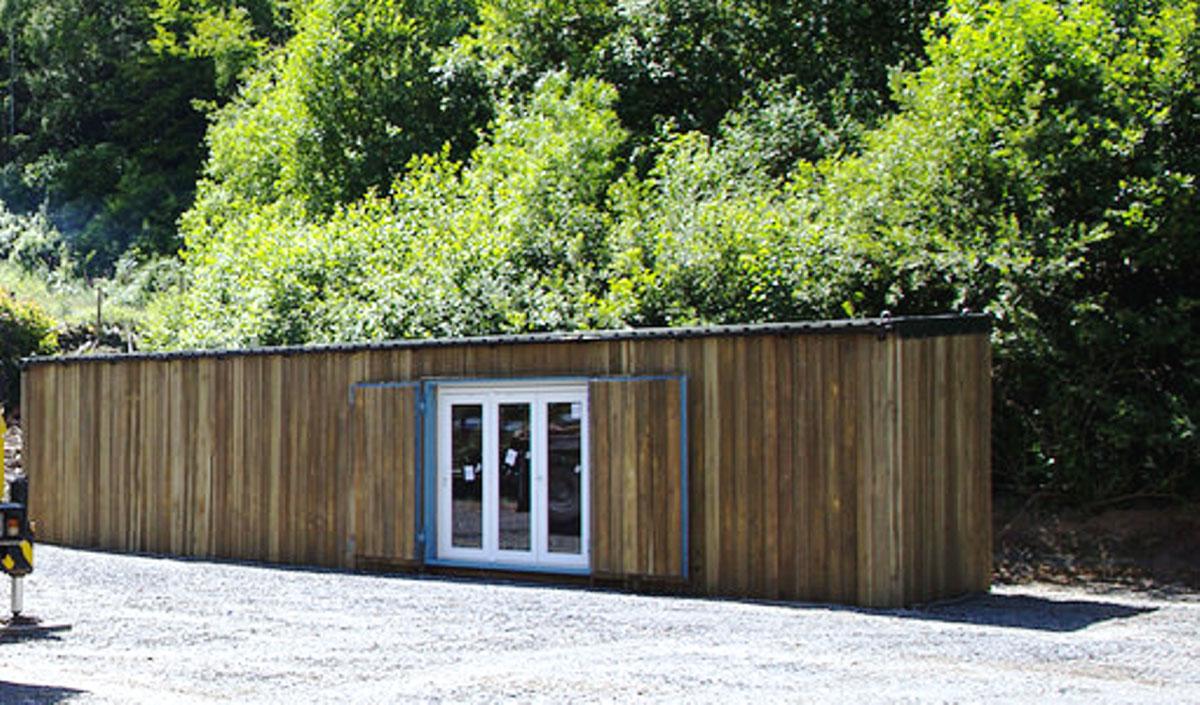 shipping container garden centre shop with bi-fold doors