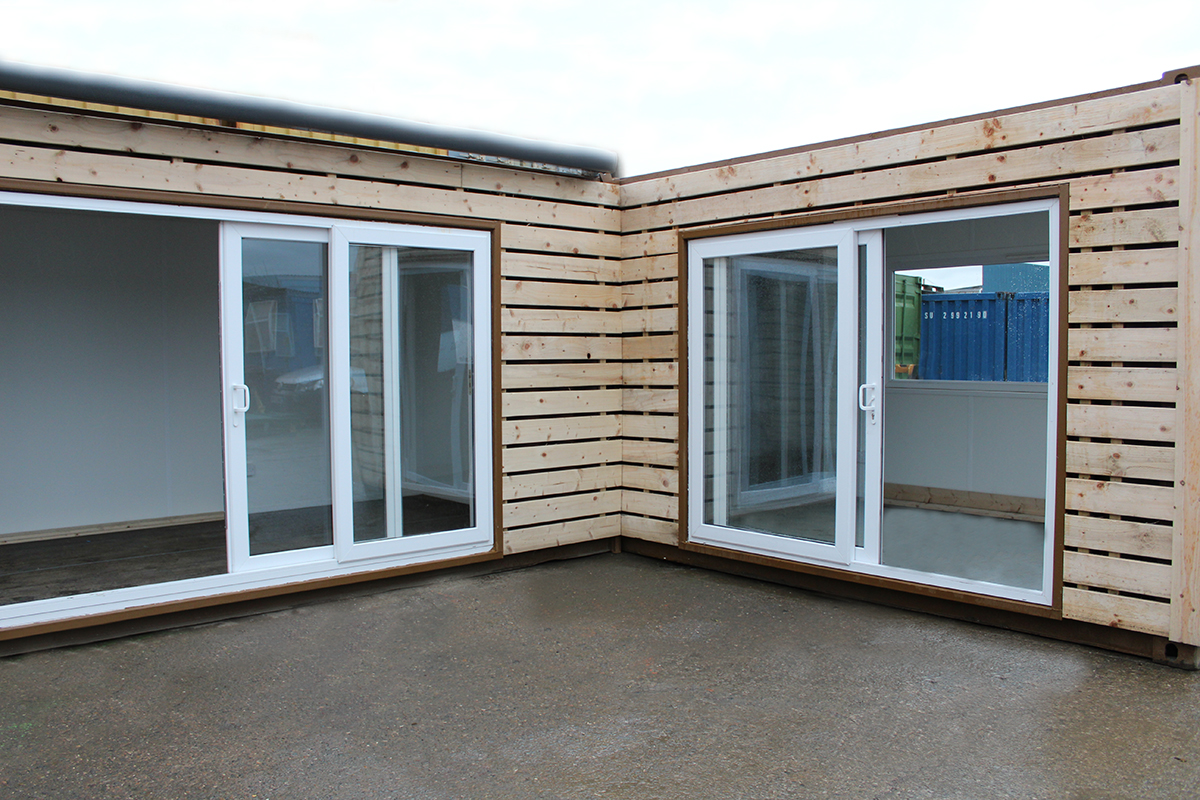 joined up shipping containers with sliding doors